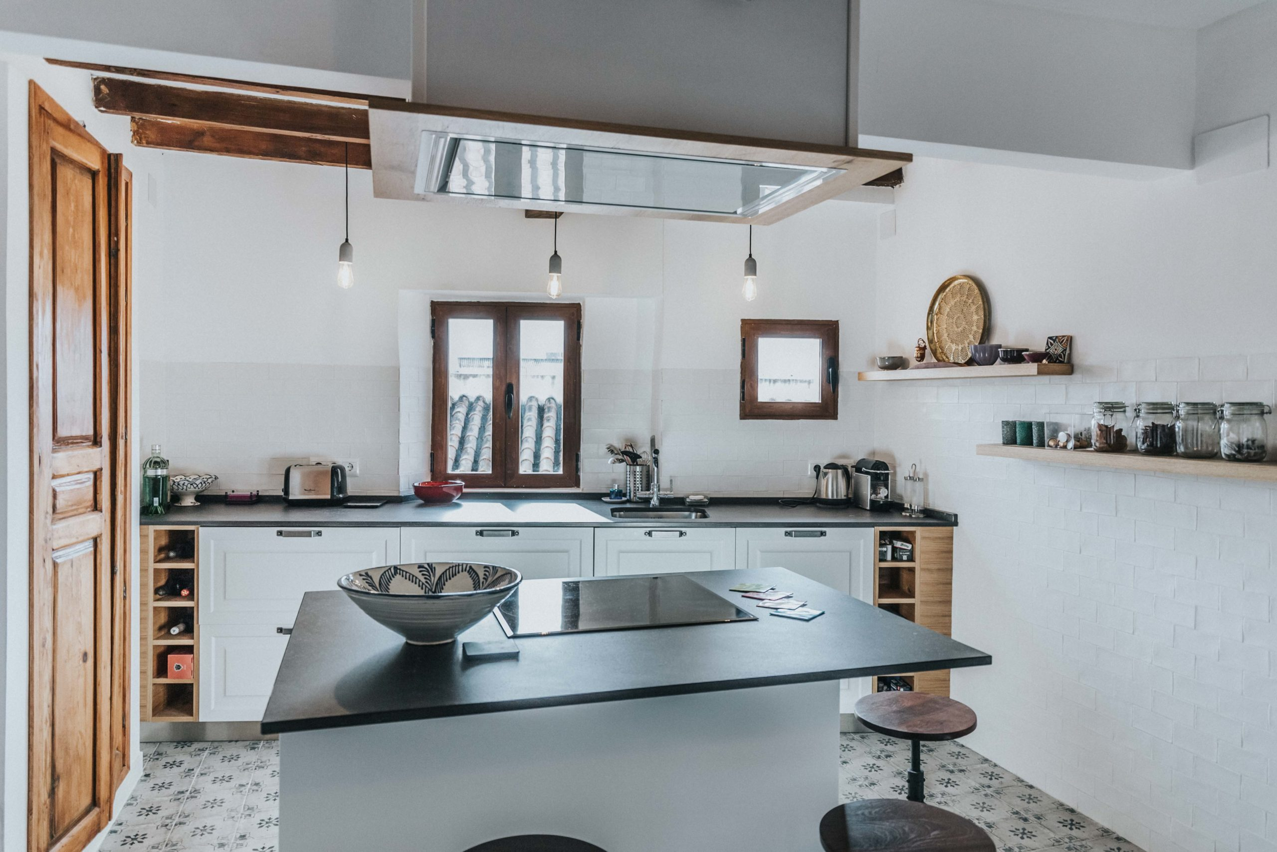 White and wood kitchen in a penthouse